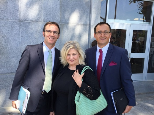 Attorneys Nicolai Cocis and Harry Mihet with Sandra Merrit at San Francisco Superior Court